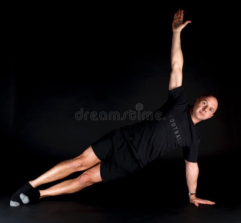 Posição de Pilates - prancha lateral fotos de stock royalty free