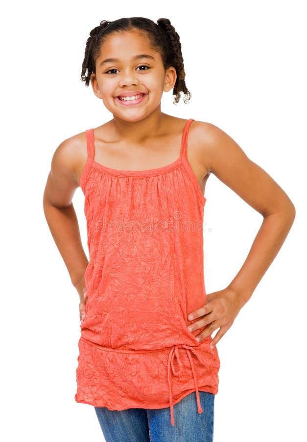 Posição e sorriso da criança foto de stock