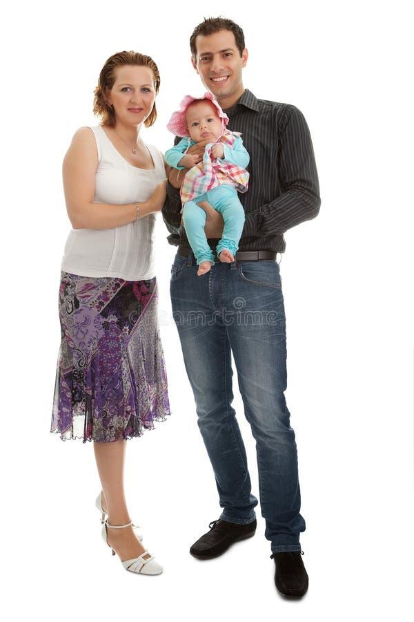 Posição nova feliz da família isolada sobre o branco fotografia de stock