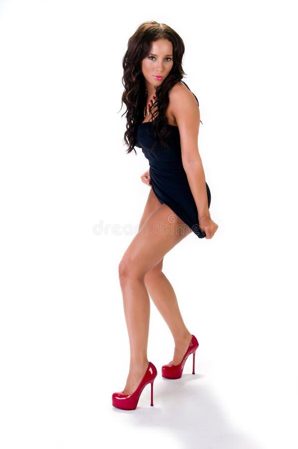 Posição sensual do brunette foto de stock royalty free