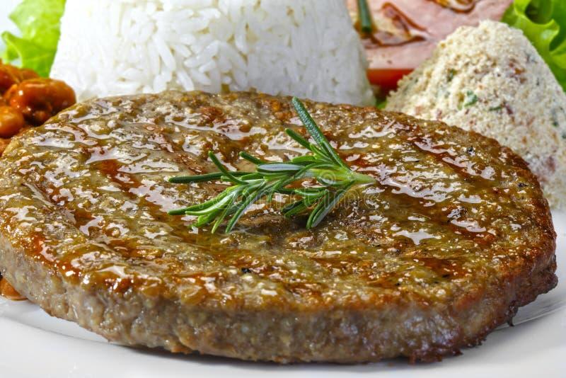 Posiłek z hamburguer mięsem obrazy stock
