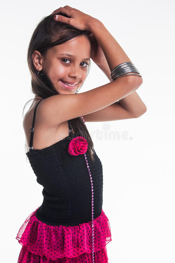Posing. Young diva who is really dressing the part, but still has a tender smile stock image