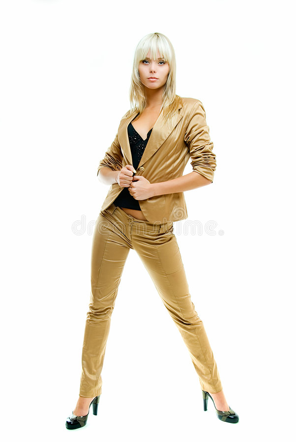Posing in gold suit. Young pretty girl in gold suit on white background stock photo