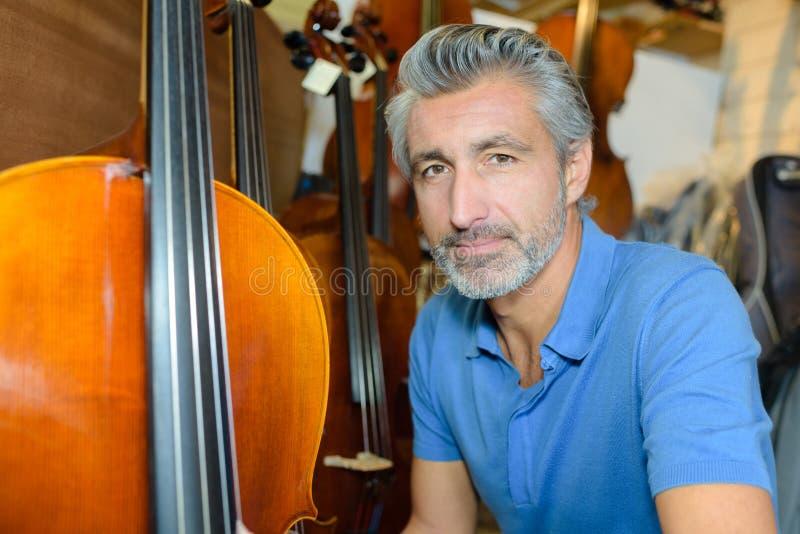 Posing next to cello. Posing next to a cello royalty free stock image