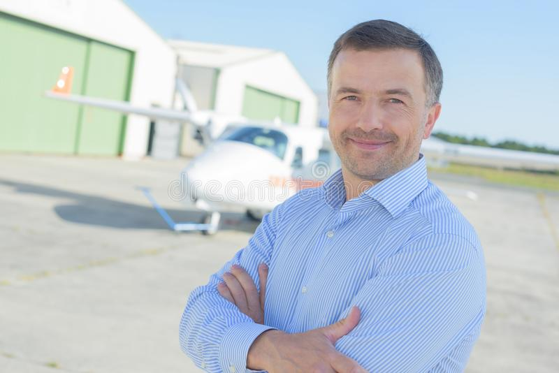 Posing outside the hangar. Pose stock photography