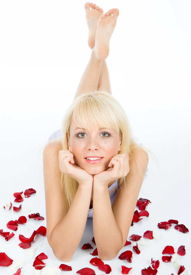 Posing on red rose petal field stock image