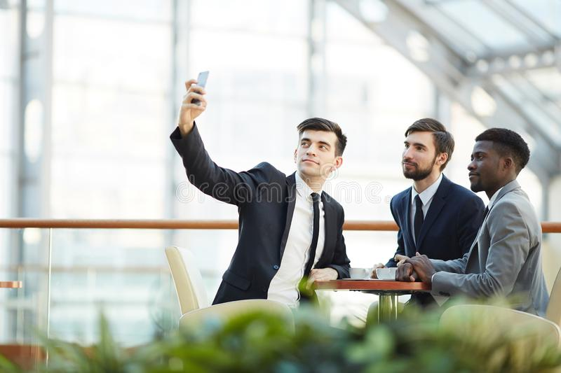 Posing for selfie with business partners stock photo