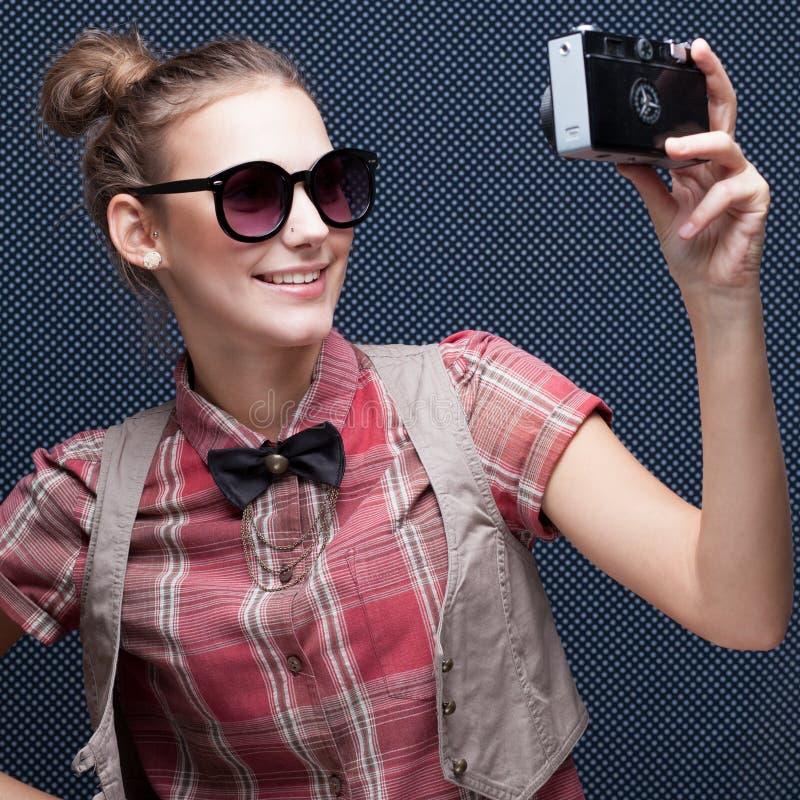 Posing during a taking selfie. Trendy girl posing during a taking selfie. Duckface stock image