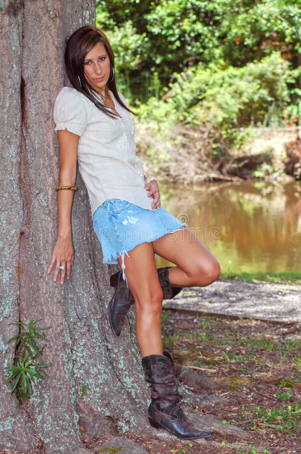 Posing by a Tree royalty free stock photo