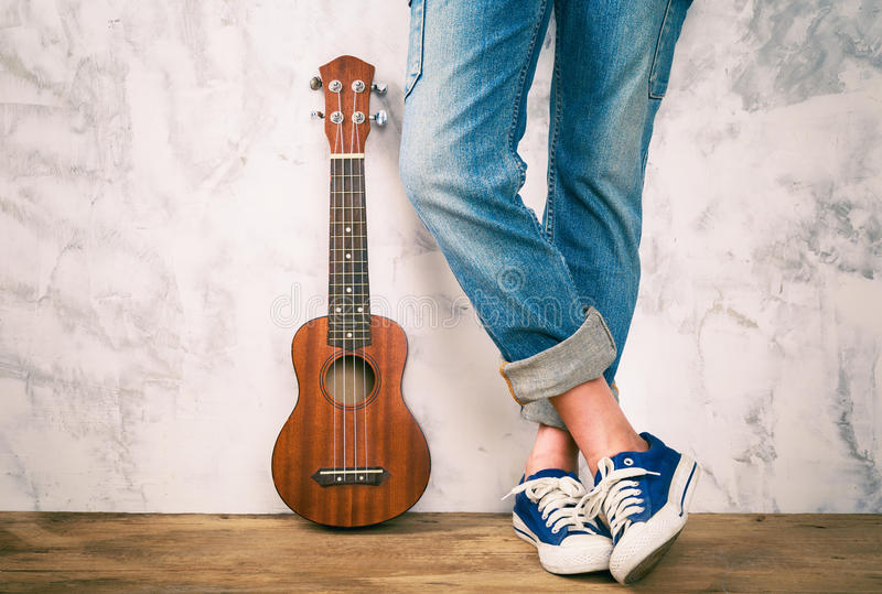 Posing with ukulele. stock photos