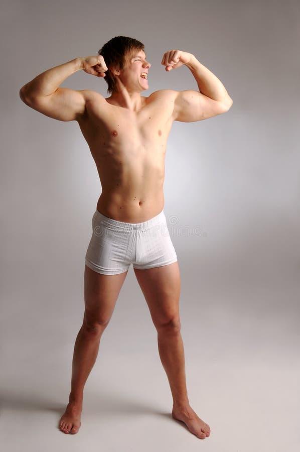 Posing young man stock photo