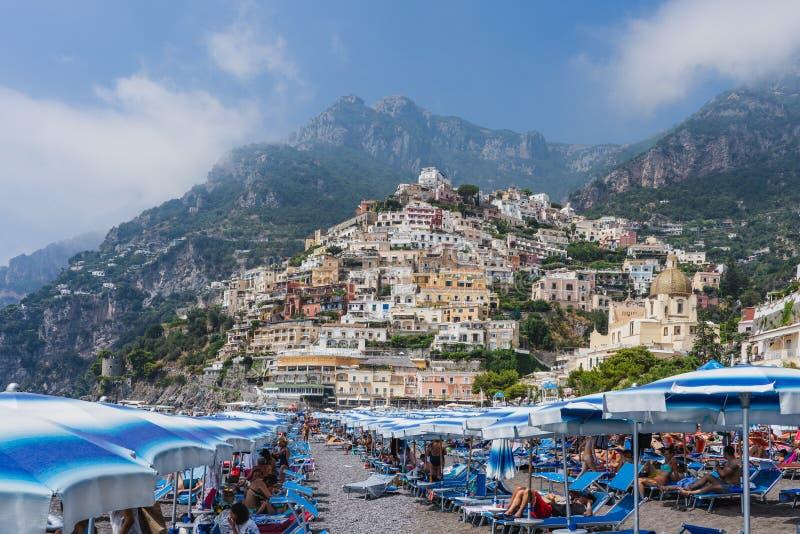 Positano, Italy - August 12, 2019: People enjoy summer beach time at Positano in Amalfi Coast. Positano, Italy - August 12, 2019: People enjoy summer beach time royalty free stock photo