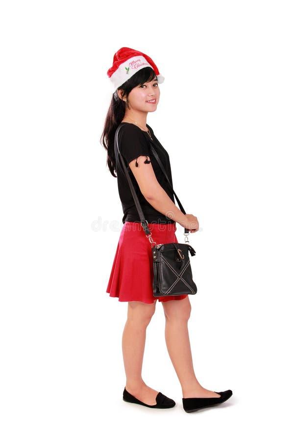 Position élégante de fille de Noël photographie stock libre de droits