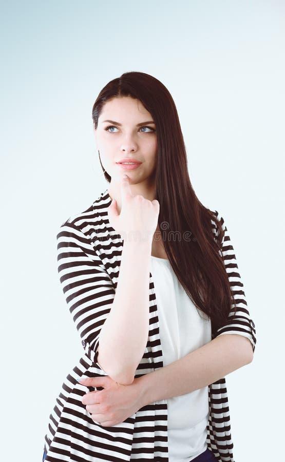 Position attrayante de jeune femme, d'isolement sur le fond blanc photos libres de droits