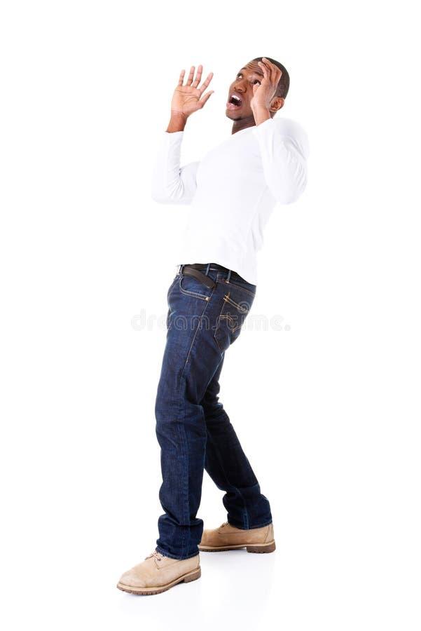 Position belle de jeune homme, effrayée. photo libre de droits