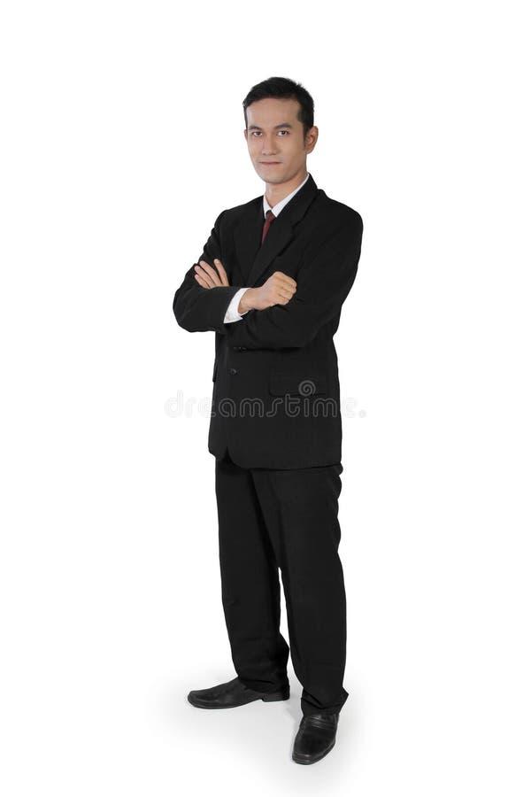 Position confiante d'homme d'affaires image stock