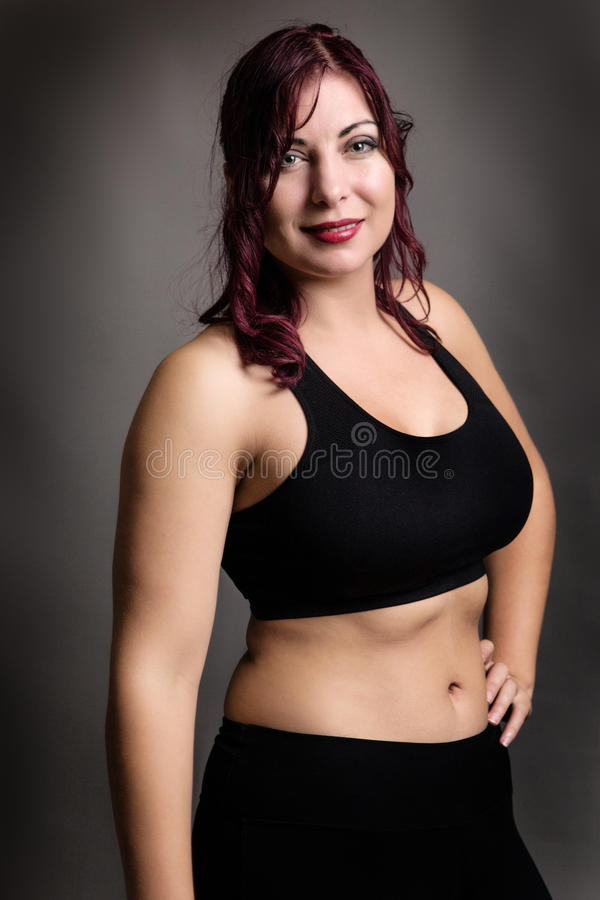 Position de femme de forme physique photos stock
