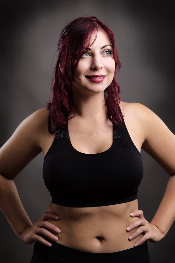 Position de femme de forme physique photographie stock