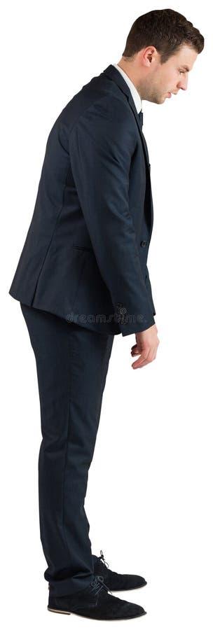 Position et cintrage d'homme d'affaires photo stock