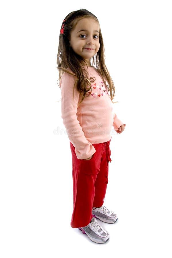 position mignonne de poche de la main une de fille photo stock