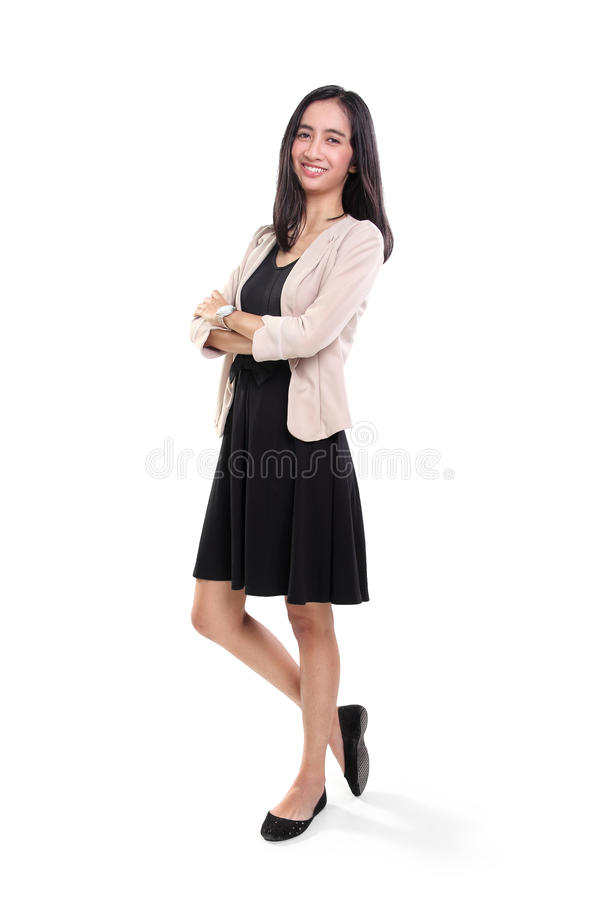 Position occasionnelle de jeune femme d'affaires gaie photos stock