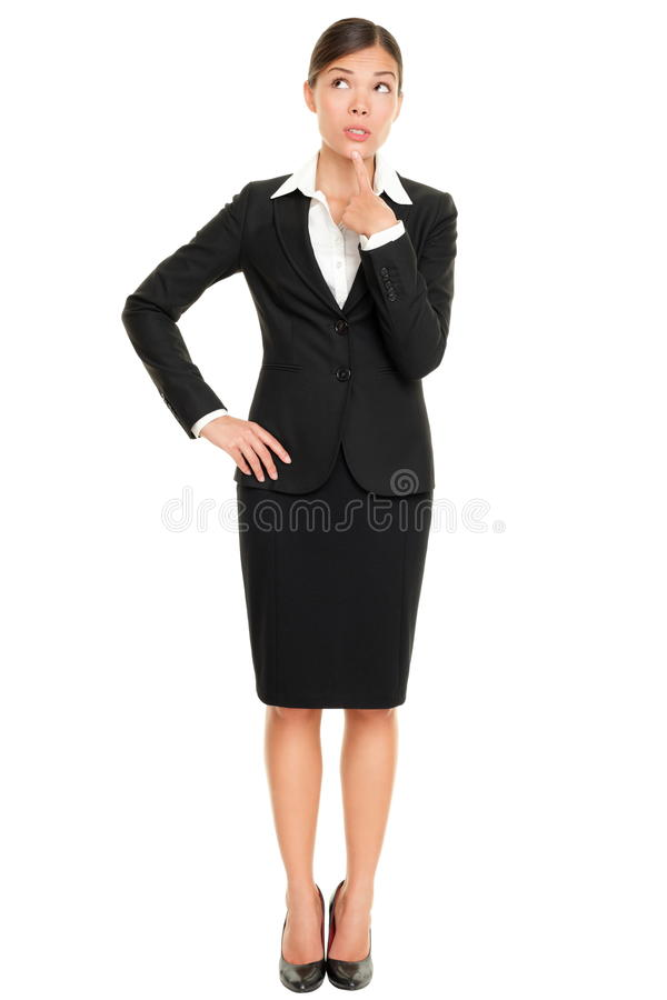 Position pensante de femme d'affaires images stock