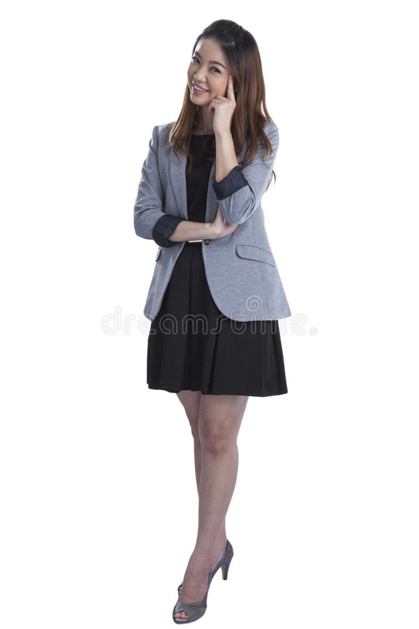 Position pensante de femme d'affaires photo stock