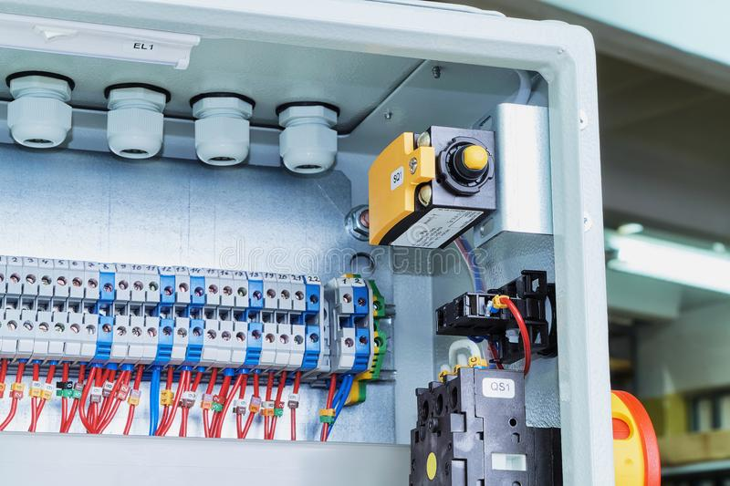 Position switch, a master switch and bushing terminals in electrical cabinet. royalty free stock image