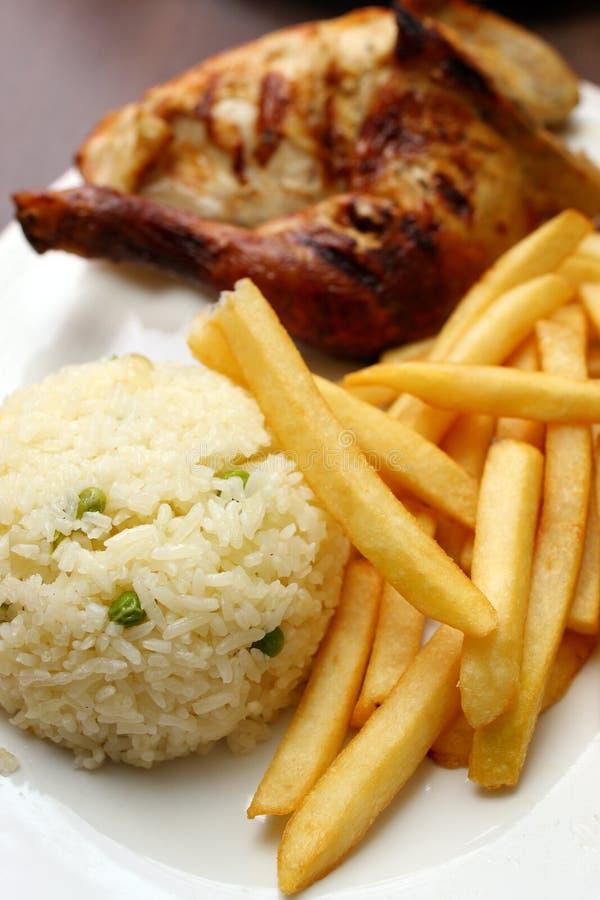 Positionnement de riz de poulet image libre de droits