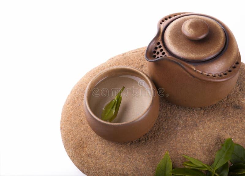 Positionnement de thé chinois avec le fond blanc image stock