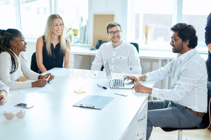Positive ambitious office workers having fun at workplace stock photos