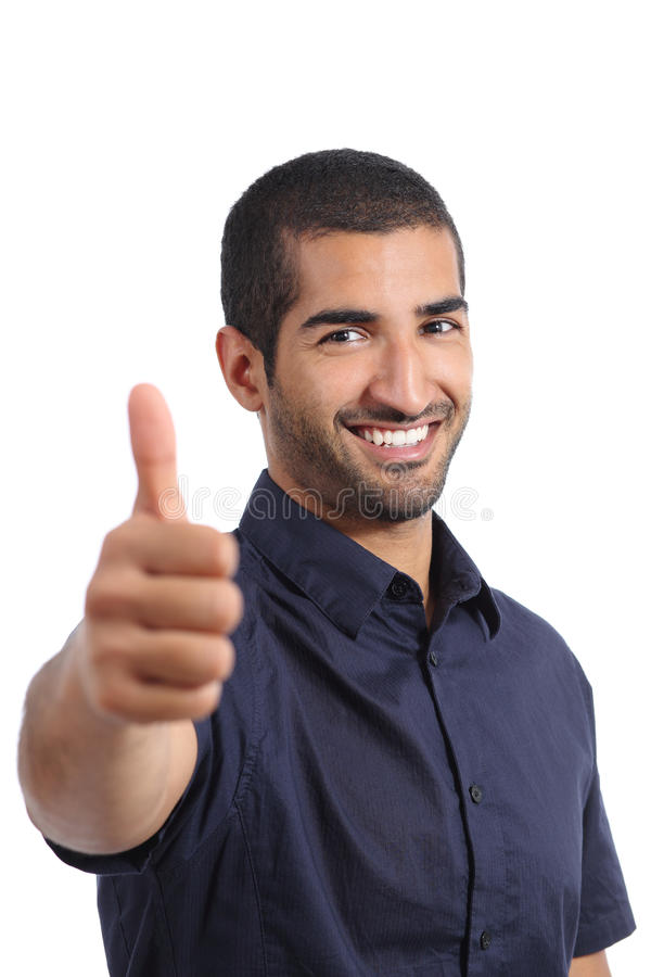 Positive arab man gesturing thumbs up stock photo