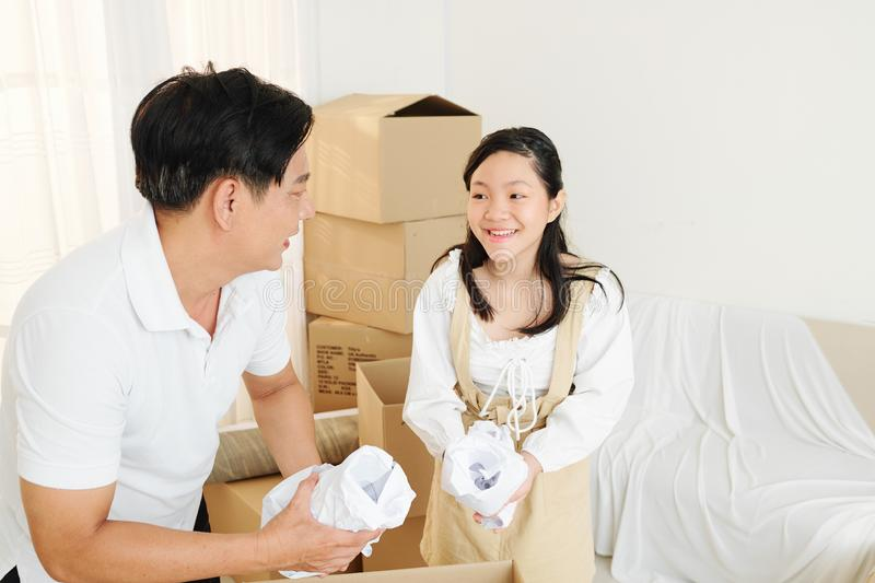 Father and daughter unpacking stuff royalty free stock photo