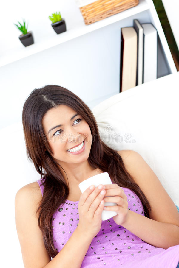 Positive Asian Woman Holding A Cup Of Coffee Stock Photos