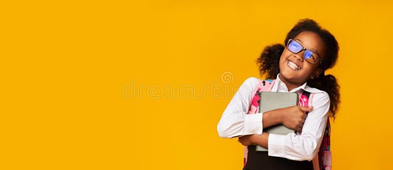 Positive Black SchoolGirl Embracing Book, Studio Shot, Panorama arkivbilder