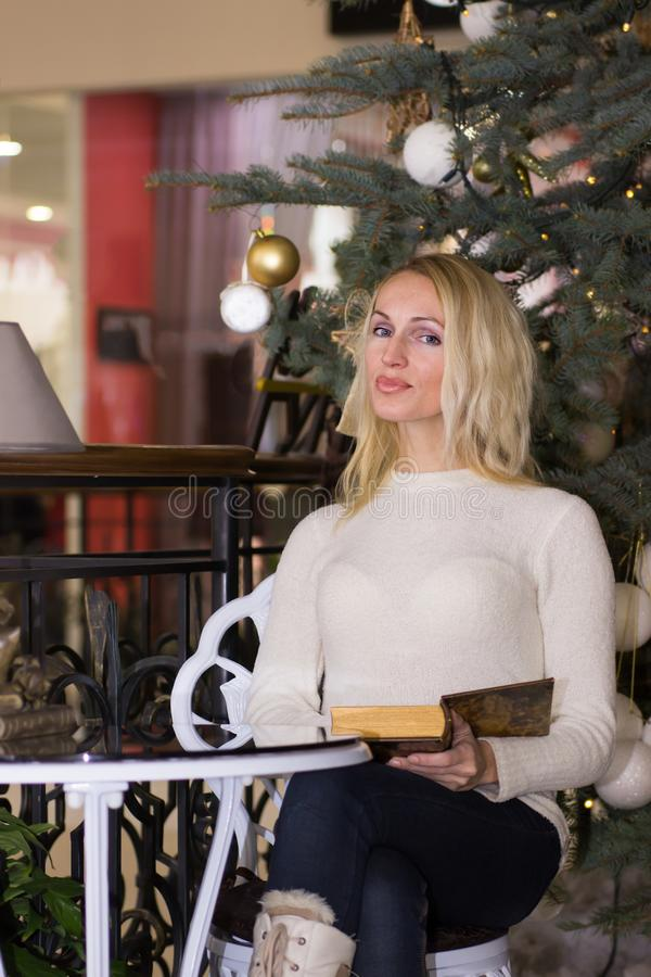Positive long hair girl celebration Christmas. Positive blonde long hair girl celebration Christmas royalty free stock photo