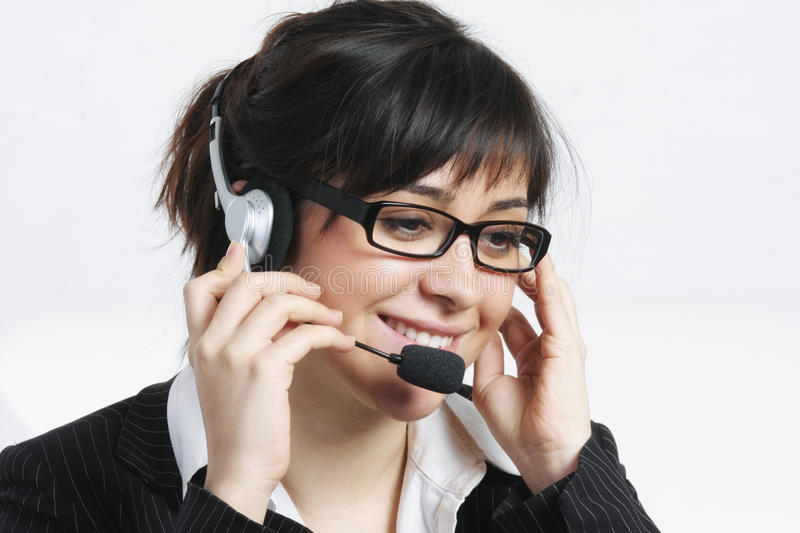 Download Positive Brunette Businesswoman With Headset Stock Image - Image: 12839955
