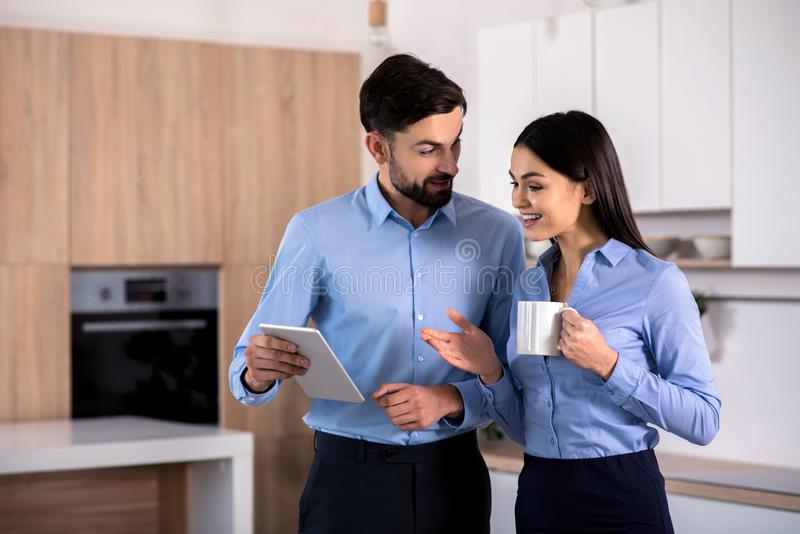 Positive business colleagues using their tablet stock photo