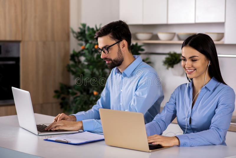 Positive business colleagues working in the kitchen stock photography