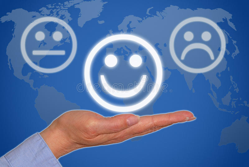 Positive business feedback. Smiley face on hand of businesswoman with world map in background; positive feedback concept royalty free stock images