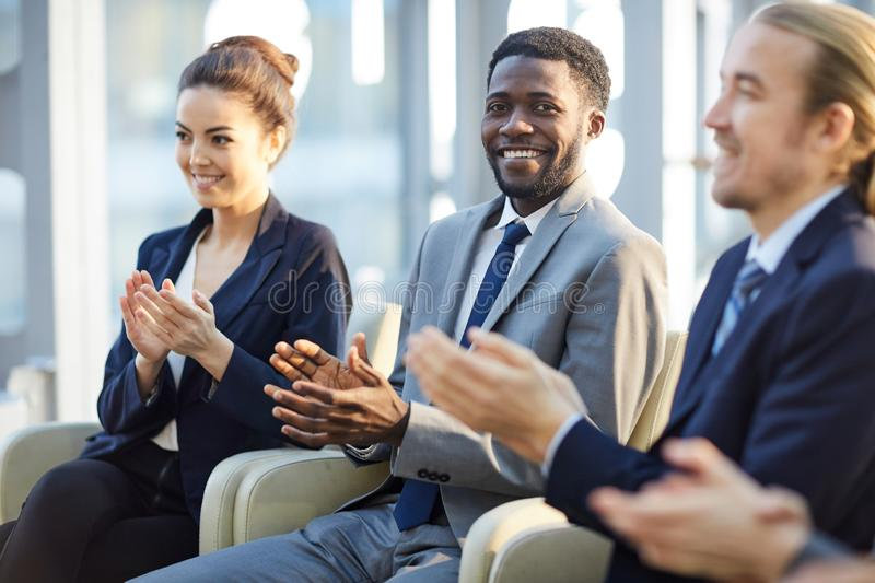 Positive business people applauding after conference royalty free stock image