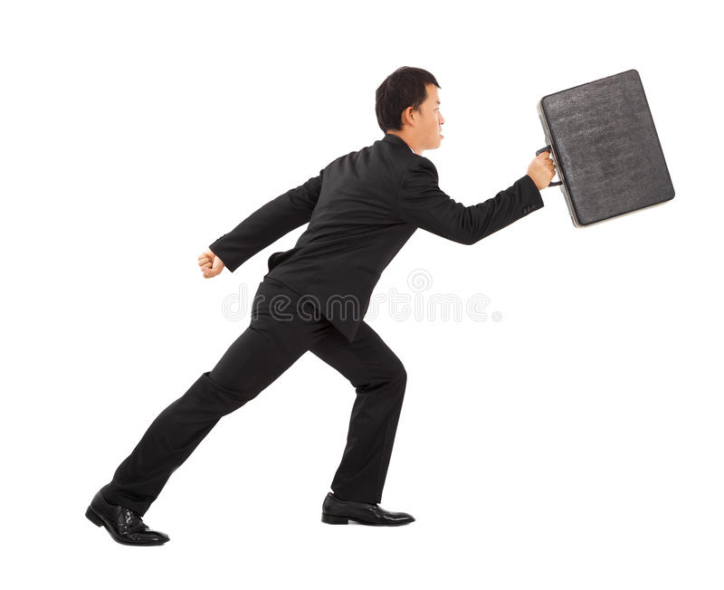 Positive businessman running and holding briefcase royalty free stock photography