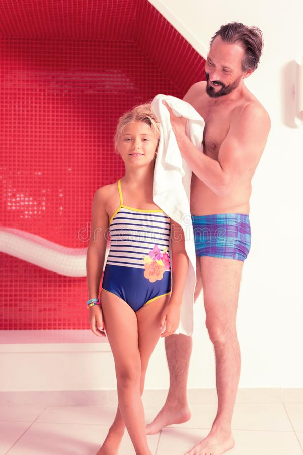 Free Positive Caring Father Drying Off His Daughters Hair Stock Images - 129074704