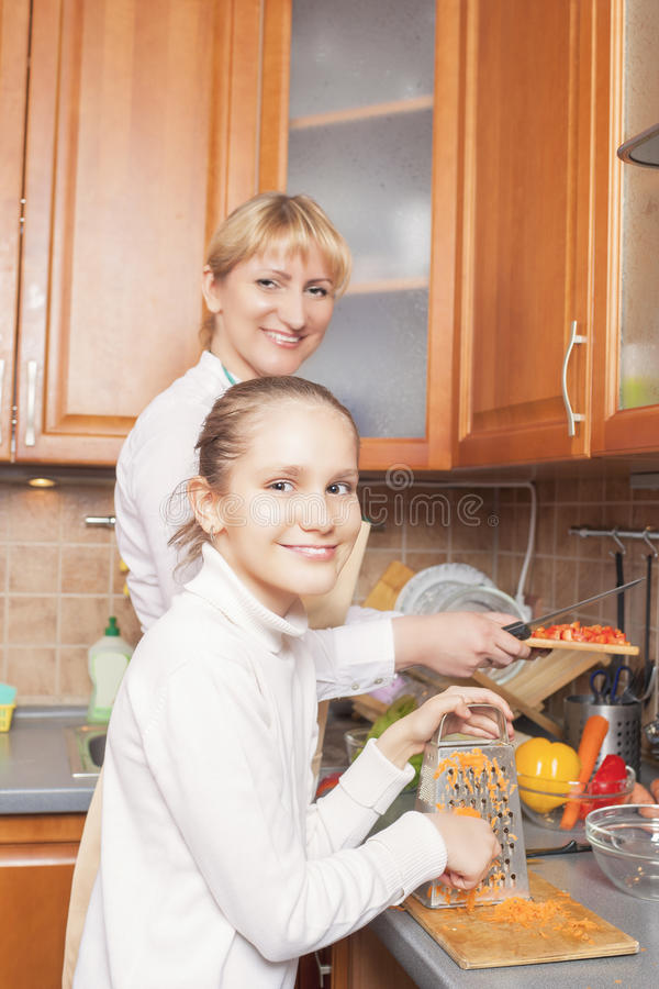 Positive Caucasian Family Preparing Food Together and Having Goo stock photo