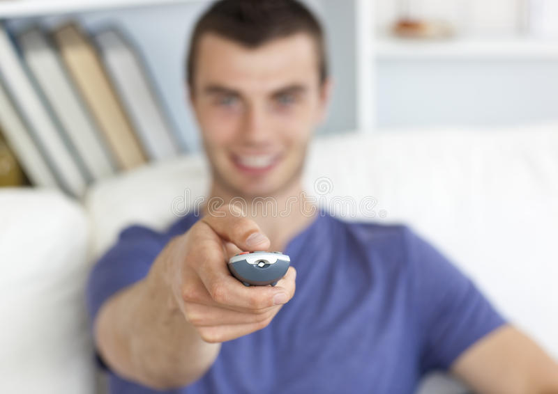Download Positive Caucasian Man Holding A Remote Stock Photo - Image: 15518928