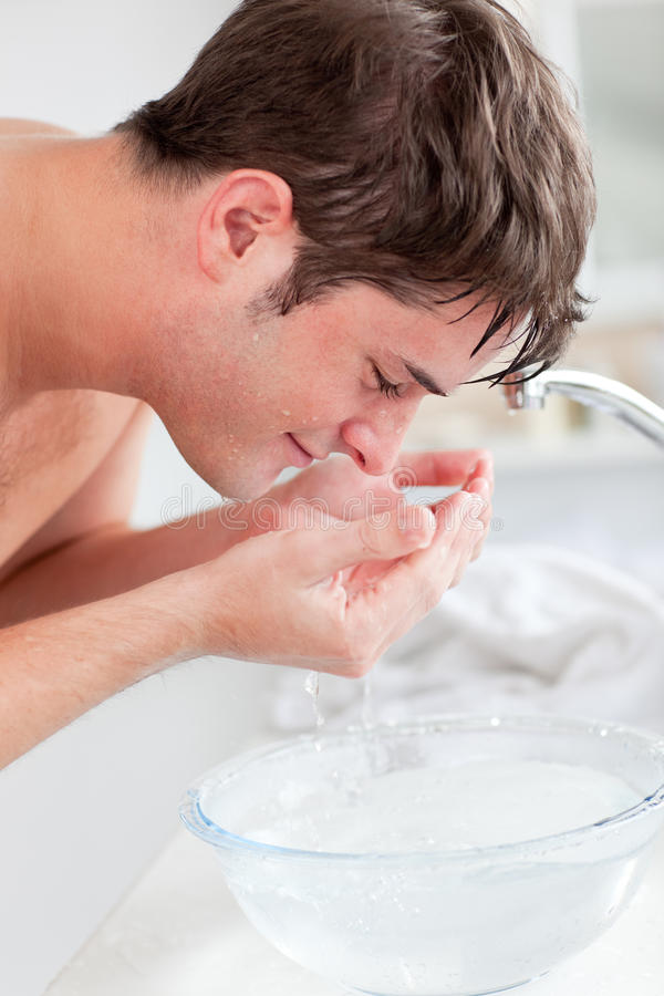 Download Positive Caucasian Man Spraying Water On His Face Stock Image - Image: 16263139