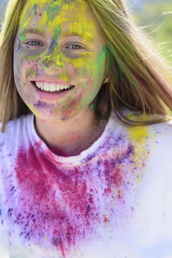 Positive and cheerful. colorful neon paint makeup. Crazy hipster girl. Summer weather. child with creative body art stock photo