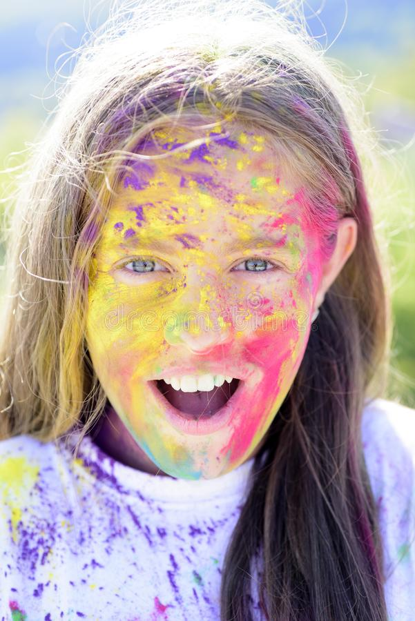Positive and cheerful. colorful neon paint makeup. Happy youth party. Optimist. Spring vibes. Crazy hipster girl. Summer. Weather. child with creative body art stock image