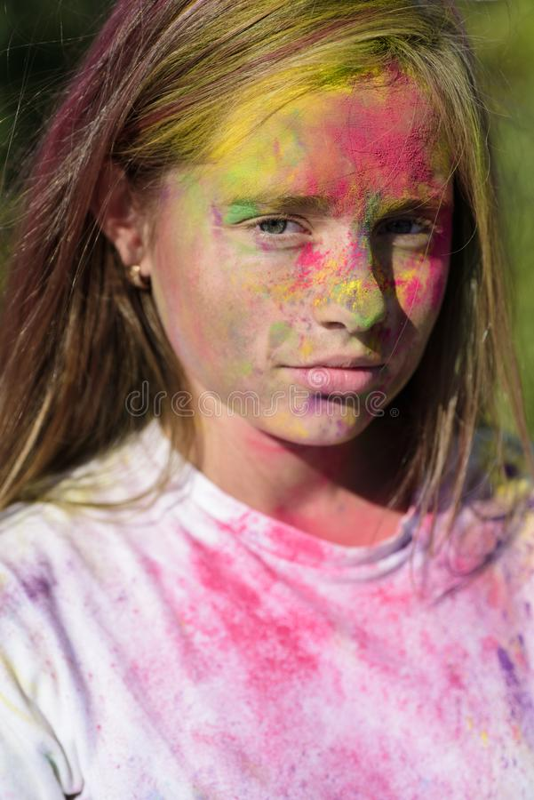 Positive and cheerful. fashion youth party. Optimist. Spring vibes. child with creative body art. colorful neon paint. Makeup. Crazy hipster girl. Summer stock image