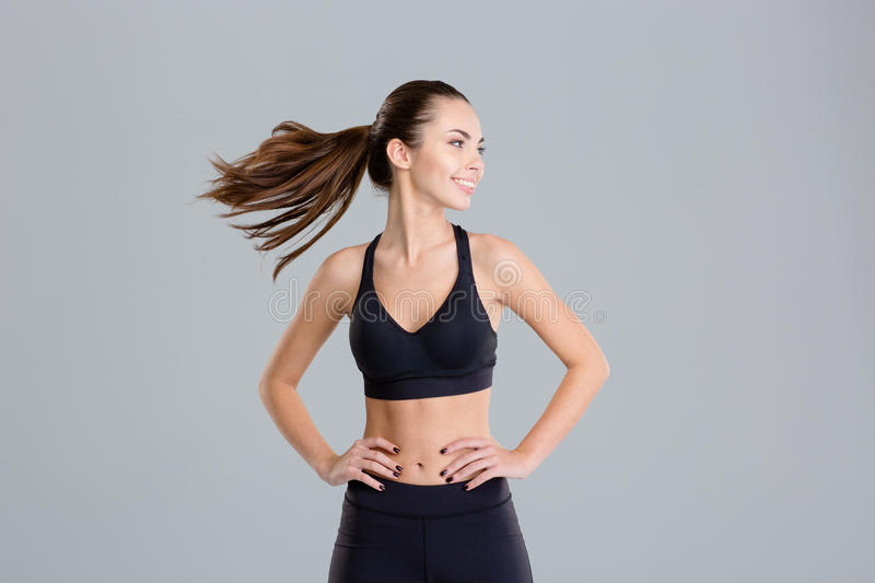 Positive cheerful fitness woman warming up and turning her head stock photography